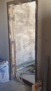 Проем в несущей стене панельного дома с усилением.